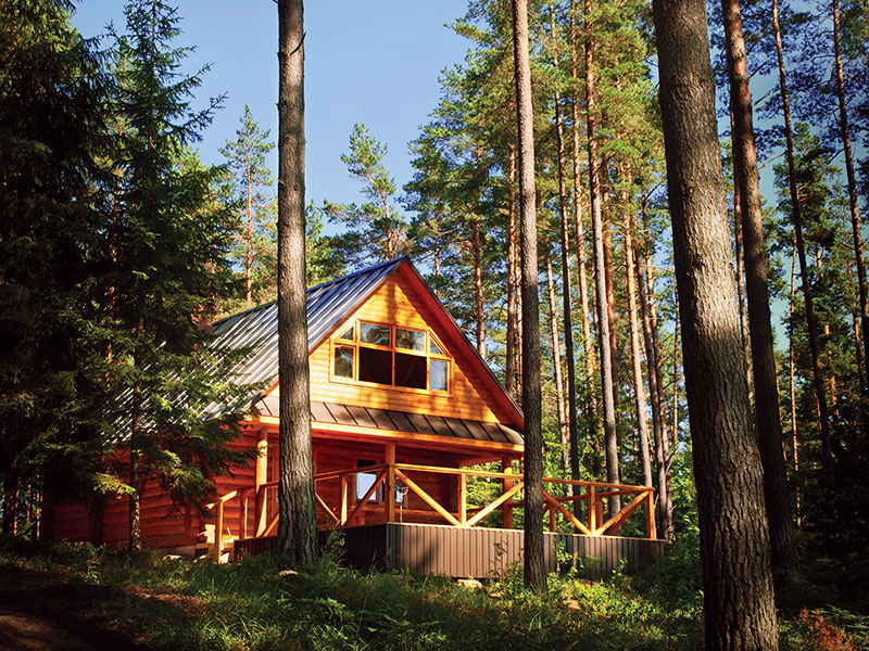 bigstock-Log-House-In-The-Forest-23527388